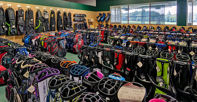 Collection of golf bags and carriers
