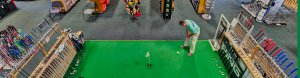 man on an indoor putting green