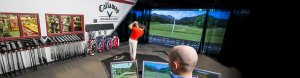 Man swinging golf club in Callaway Performance Center bay