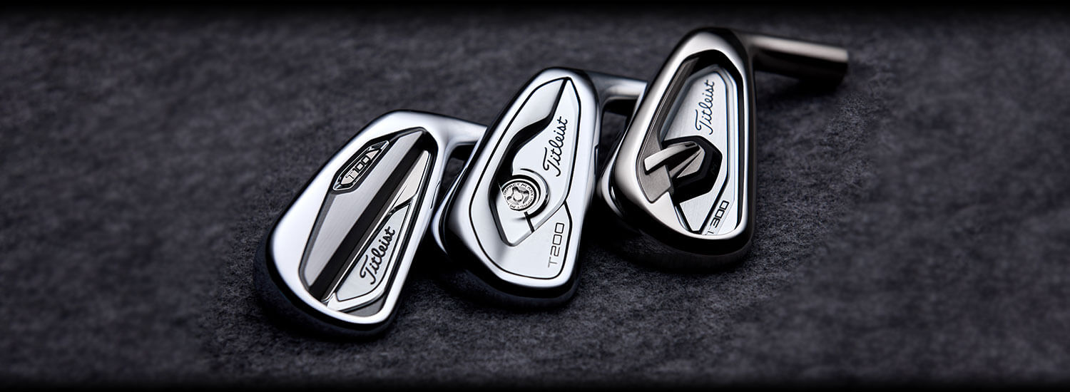 Titleist T-series golf club heads sitting on a felt surface. Showing three chrome finished club heads
