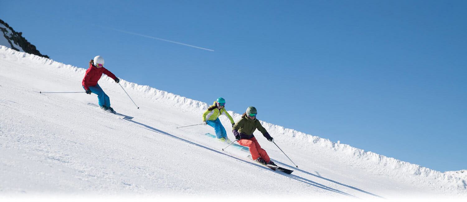 Skiers coming down a slope